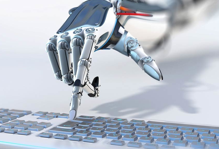 Robotic hand using a keyboard to demonstrate value-driven robotic process automation